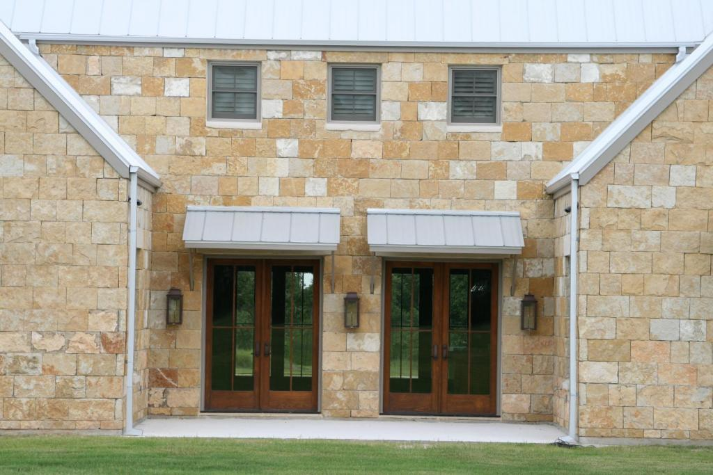 "<a href=""/node/237"">CUSTOM PINE DOUBLE DOORS ARE FLANKED BY BEVELO GAS LIGHTS AND ARE PROTECTED BY AWNINGS FEATURING STANDING SEAM METAL</a>"