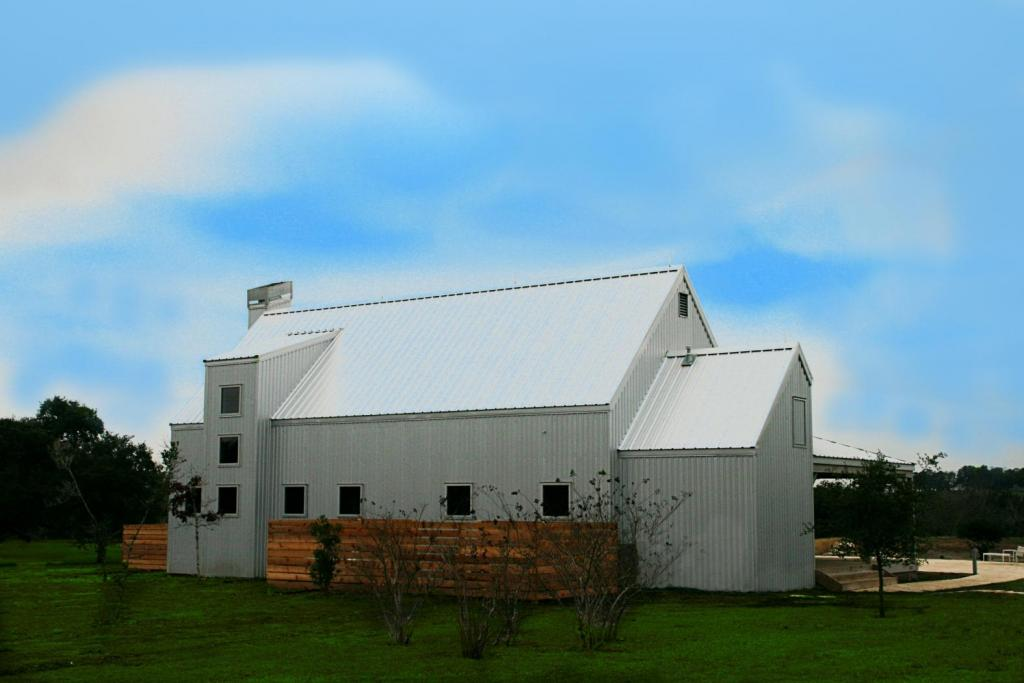 """<a href=""""/node/173"""">CONTEMPORARY HORIZONTAL FENCING COMPLIMENTS THE DESIGN OF THE HOUSE AND DOUBLES AS THE PERFECT CONCEALMENT OF THE POOL AND OUTDOOR UTILITIES. THIS PROJECT IS A CONTEMPORARY TAKE ON A CENTRAL TEXAS BARN FEATURING GALVALUME SIDING, ROOFING AND TRIM.</a>"""