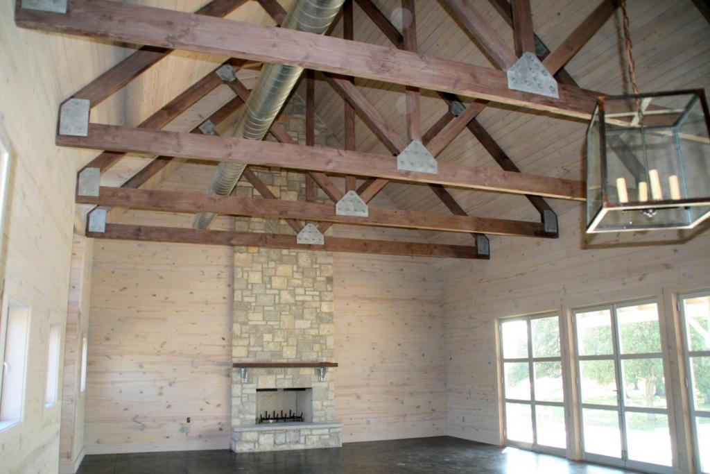 "<a href=""/node/178"">CUSTOM SITE-BUILT TIMBER TRUSSES MADE FROM DOUGLAS FIR ARE HELD TOGETHER BY CUSTOM GALVANIZED BRACKETS. THE FIREPLACE, MADE FROM LEUDERS STONE, FEATURES CUSTOM GALVANIZED METAL BRACKETS.</a>"