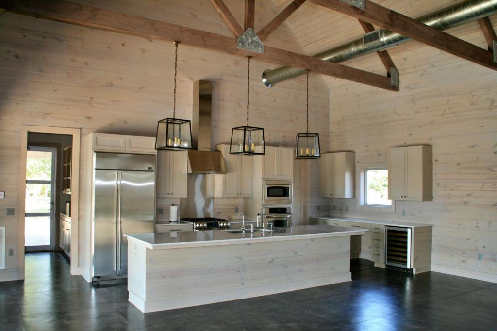 """<a href=""""/node/177"""">KITCHEN FEATURING A CARRARA MARBLE COUNTERTOP, SUBZERO COMMERCIAL FRIDGE, A CUSTOM STAINLESS BACKSPLASH AND SCORED CONCRETE FLOORS. THE MUDROOM IS CONVENIENTLY PLACED TO ENTER INTO THE KITCHEN.</a>"""
