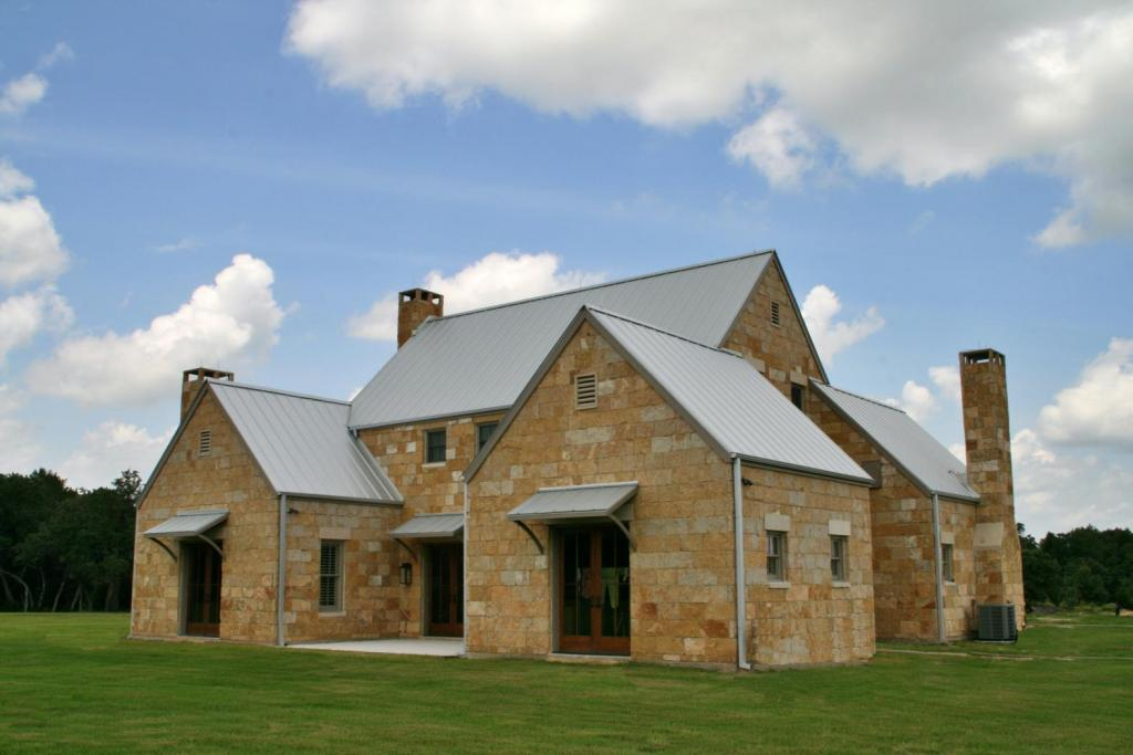 """<a href=""""/node/236"""">CUSTOM 3 BEDROOM, 3 1/2 BATH HOME FEATURING CUT AND DRY STACK LIMESTONE EXTERIOR WITH CUT STONE HEADERS ABOVE WINDOWS AND DOORS. THE HOME BOASTS 7 SETS OF CUSTOM PINE DOUBLE DOORS AND A GALVALUME STANDING SEAM ROOF WITH CUSTOM GUTTER SYSTEM.</a>"""